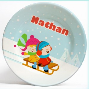 Boy and Girl Sledding name plate. Unique personalized dinner plate for kids. PersonalizedKidsPlates.com